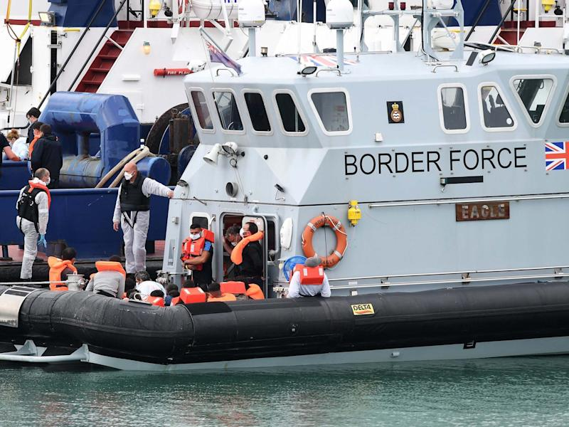 Border Force officials bring in migrants who made the crossing from France to Dover in AugustEPA