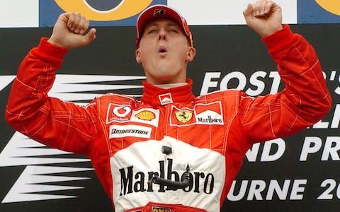 <span>A familiar sight in F1 in the 2000s - Michael Schumacher celebrating a race victory</span> <span>Credit: AP </span>