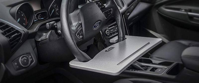 AutoExec Wheelmate Steering Wheel Attachable Work Surface Tray in use in someone's car