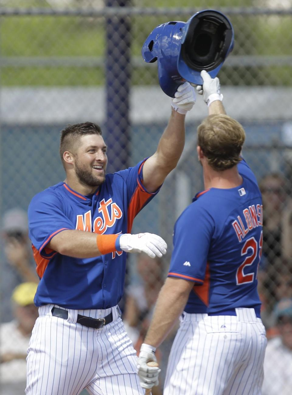 <p>Tim Tebow is greeted by Peter Alonso after hitting a solo home run in his first at bat during the first inning of his first instructional league baseball game for the New York Mets against the St. Louis Cardinals instructional club Wednesday, Sept. 28, 2016, in Port St. Lucie, Fla. (AP Photo/Luis M. Alvarez) </p>