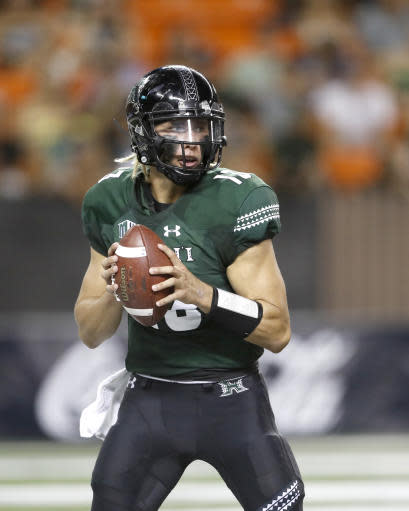 Hawaii quarterback Cole McDonald (13) looks for an open receiver during the second quarter of an NCAA college football game against Duquesne Saturday, Sept. 22, 2018, in Honolulu. (AP Photo/Marco Garcia)