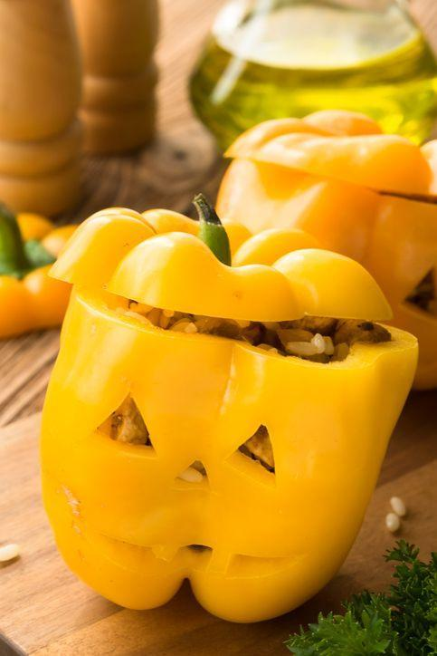 """<p>You can use our slow cooker stuffed pepper recipe (or any recipe you prefer!) to create this fun dinner idea. All you have to do is carve a little face in the pepper!</p><p><strong><em><a href=""""https://www.womansday.com/food-recipes/food-drinks/recipes/a11747/slow-cooker-sausage-potato-onion-stuffed-peppers-recipe-124105/"""" rel=""""nofollow noopener"""" target=""""_blank"""" data-ylk=""""slk:Get the Slow Cooker Sausage, Potato and Onion-Stuffed Peppers recipe."""" class=""""link rapid-noclick-resp"""">Get the Slow Cooker Sausage, Potato and Onion-Stuffed Peppers recipe. </a></em></strong></p>"""