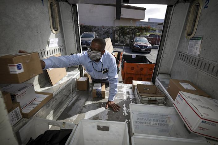 James Daniels loads mail into his truck.