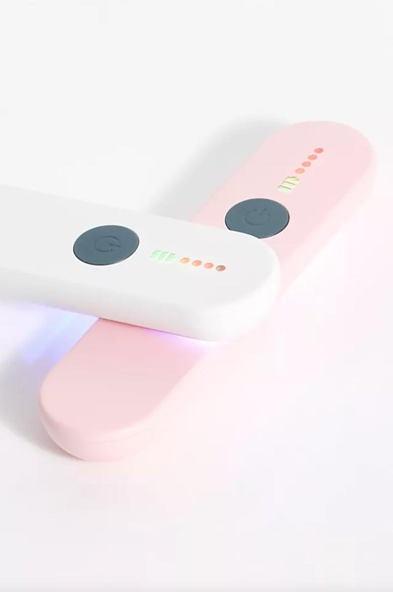 """<p>""""This nifty little <span> Phunkee Tree Mini UV Sanitizing Wand </span> $70 disinfects surfaces in seconds, so I'll be carrying it in my purse with my everywhere I go. You can use it for phones, bedding, countertops, credit cards, and lots more."""" - MCW</p>"""