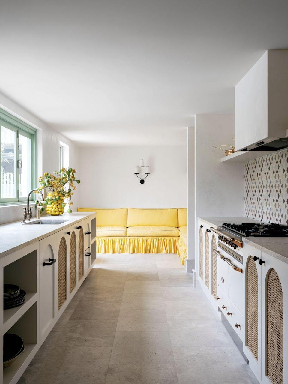 """<p>If you're blessed with an open-plan kitchen, there's even more opportunity to add colour. Furniture is an easy way to inject a bright pop of your favourite shade – a yellow banquette uplifts the kitchen in this <a href=""""https://elledecoration.co.uk/houses/a36379344/sydney-home-handelsmann-khaw/"""" rel=""""nofollow noopener"""" target=""""_blank"""" data-ylk=""""slk:Sydney home"""" class=""""link rapid-noclick-resp"""">Sydney home</a> designed by Handelsmann + Khaw. See our guide to the <a href=""""https://elledecoration.co.uk/directory/g36753767/best-vintage-furniture-restoration/"""" rel=""""nofollow noopener"""" target=""""_blank"""" data-ylk=""""slk:UK's best furniture restorers"""" class=""""link rapid-noclick-resp"""">UK's best furniture restorers</a> for upholstery experts who can add a fresh jolt of colour to existing pieces.</p>"""