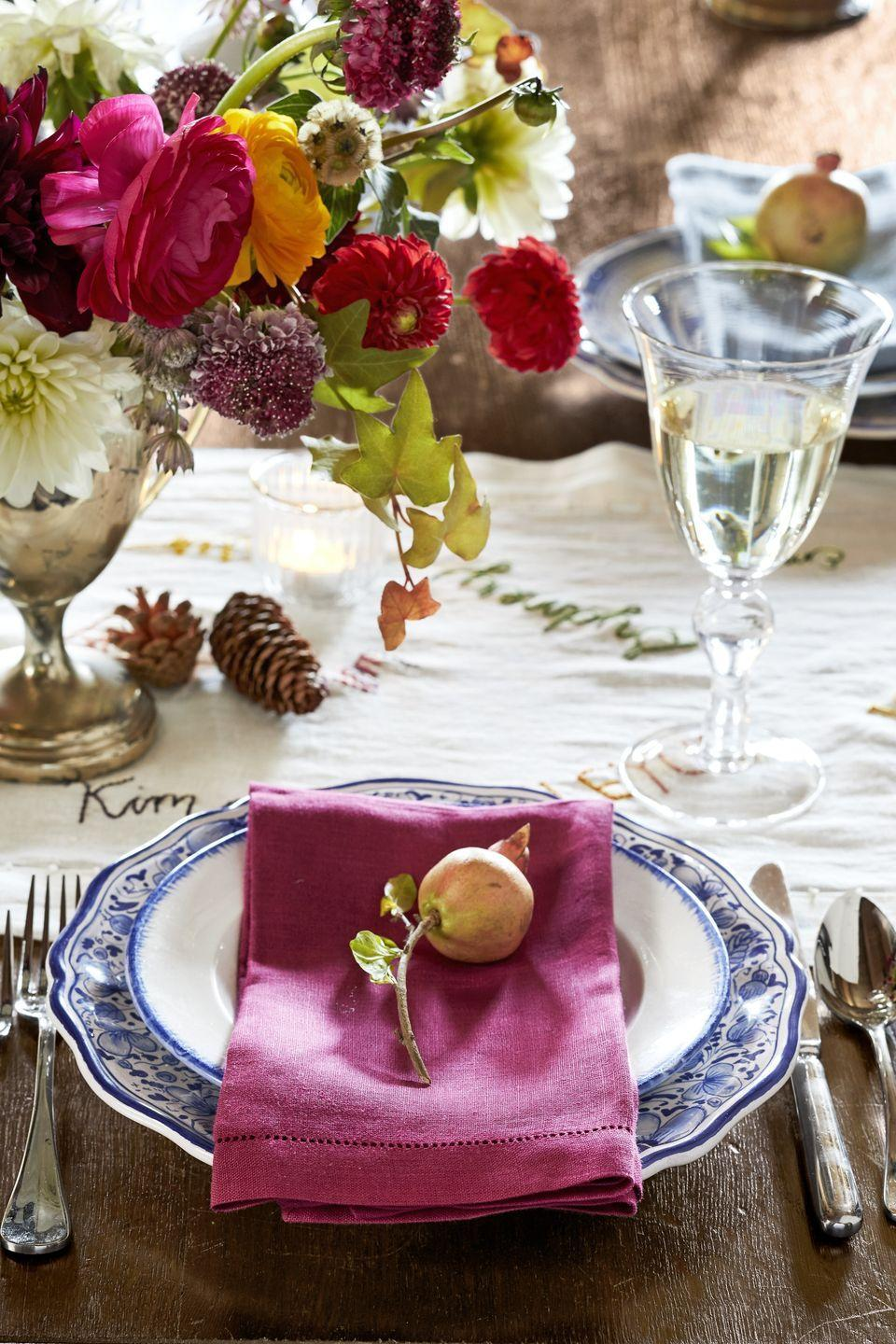 """<p>Create a simple, yet chic, tablescape with pieces of seasonal fruit topping a linen napkin laid on each plate. Add vases of fresh flowers in vintage trophies down the table too for an effortlessly undone fall look. </p><p><a class=""""link rapid-noclick-resp"""" href=""""https://www.amazon.com/Cotton-Craft-Napkins-20-Inch-Multi-Colors/dp/B009LI9O0E/?tag=syn-yahoo-20&ascsubtag=%5Bartid%7C10050.g.1371%5Bsrc%7Cyahoo-us"""" rel=""""nofollow noopener"""" target=""""_blank"""" data-ylk=""""slk:SHOP LINEN NAPKINS"""">SHOP LINEN NAPKINS</a></p>"""