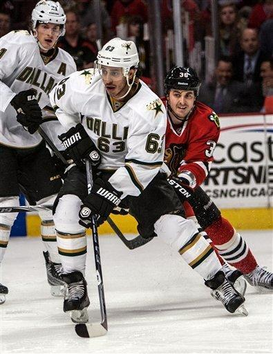 Dallas Stars' Mike Ribeiro (63) has Chicago Blackhawks' Dave Bolland, right, on his tail as he stick-handles during the first period of an NHL hockey game in Chicago, Thursday, Feb. 23, 2012. (AP Photo/Charles Cherney)