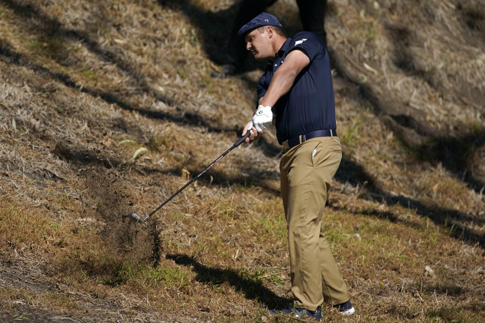 Bryson DeChambeau hits his second shot out of the rough on the fifth hole during the first round of the Genesis Invitational golf tournament at Riviera Country Club, Thursday, Feb. 18, 2021, in the Pacific Palisades area of Los Angeles. (AP Photo/Ryan Kang)