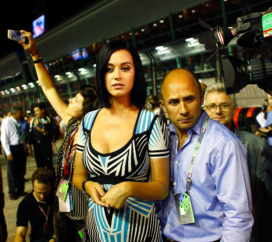 SINGAPORE , SINGAPORE - SEPTEMBER 23:  Singer Katy Perry is pictured on the starting grid ahead of the Formula One Grand Prix of Singapore at Marina Bay Street Circuit on September 23, 2012 in Singapore, Singapore.  (Photo by Vladimir Rys Photography/Getty Images)