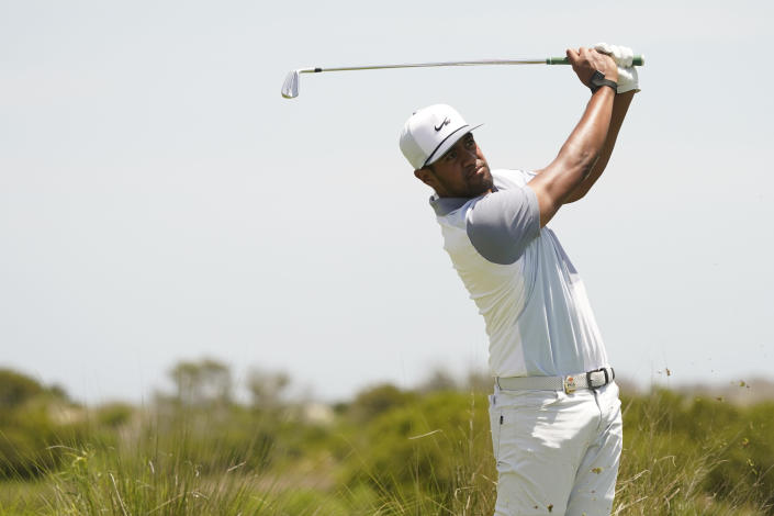 Tony Finau hits on the fifth tee during the third round at the PGA Championship golf tournament on the Ocean Course, Saturday, May 22, 2021, in Kiawah Island, S.C. (AP Photo/Matt York)