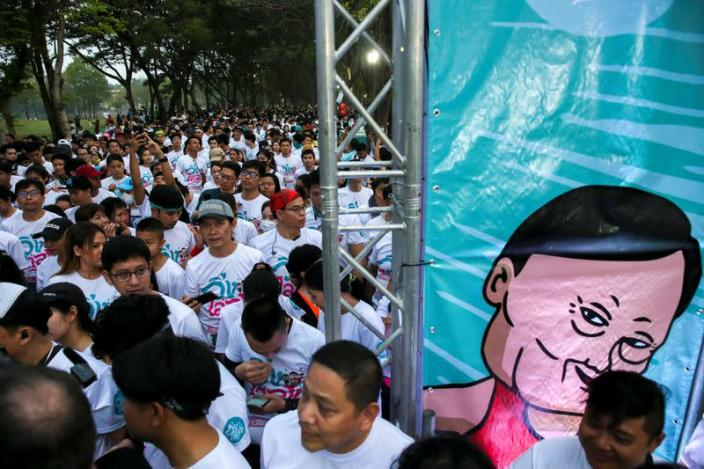 """Runners attend a """"Run Against Dictatorship"""" event at a Public park in Bangkok"""