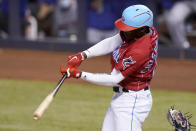 Miami Marlins' Jazz Chisholm Jr. hits a single during the first inning of the team's baseball game against the New York Mets, Friday, May 21, 2021, in Miami. (AP Photo/Lynne Sladky)