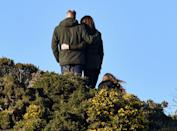 <p>The Duke and Duchess of Cambridge stand on Howth Cliffs with their arms wrapped around each other during their trip to Dublin, Ireland. </p>