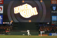 San Francisco Giants' Buster Posey (28) rounds the bases after hitting a two-run home run against the Los Angeles Dodgers during the first inning of Game 1 of a baseball National League Division Series Friday, Oct. 8, 2021, in San Francisco. (AP Photo/Jed Jacobsohn)