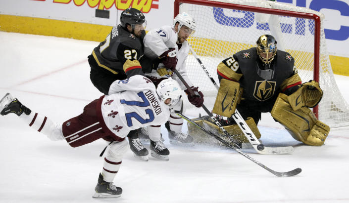 Colorado Avalanche right wing Joonas Donskoi (72) shoots against Vegas Golden Knights goaltender Marc-Andre Fleury (29) as Golden Knights defenseman Shea Theodore (27) and Avalanche center Tyson Jost (17) position in the crease during the second period of an NHL hockey game in Denver, Saturday, March 27, 2021. (AP Photo/Joe Mahoney)