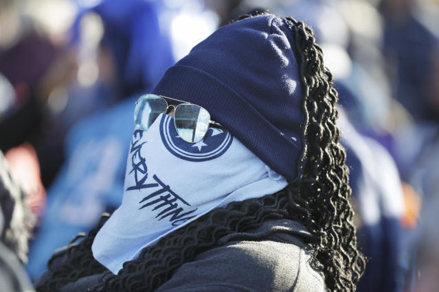 Tennessee Titans fan Jaime Wallace braves the cold weather at an outdoor viewing party in Nashville, Tenn., to watch the team play the Kansas City Chiefs in the AFC Championship NFL football game Sunday, Jan. 19, 2020. (AP Photo/Mark Humphrey)