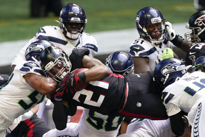 Atlanta Falcons running back Todd Gurley (21) runs into the end zone for a touchdown against the Seattle Seahawks during the first half of an NFL football game, Sunday, Sept. 13, 2020, in Atlanta. (AP Photo/John Bazemore)