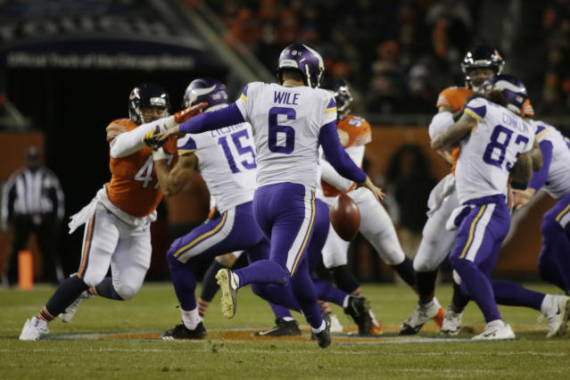 """FILE - In this Nov. 18, 2018, file photo, Minnesota Vikings' Matt Wile (6) punts during the second half of an NFL football game against the Chicago Bears in Chicago. Coach Mike Zimmer said he was """"at a loss"""" about his specialists, after Kaare Vedvik missed two field goals in the last exhibition game. With four days left before roster reduction day, the Vikings still don't have clarity about whether kicker Dan Bailey and punter Matt Wile will stay or if Vedvik will replace one of them. (AP Photo/David Banks, File)"""