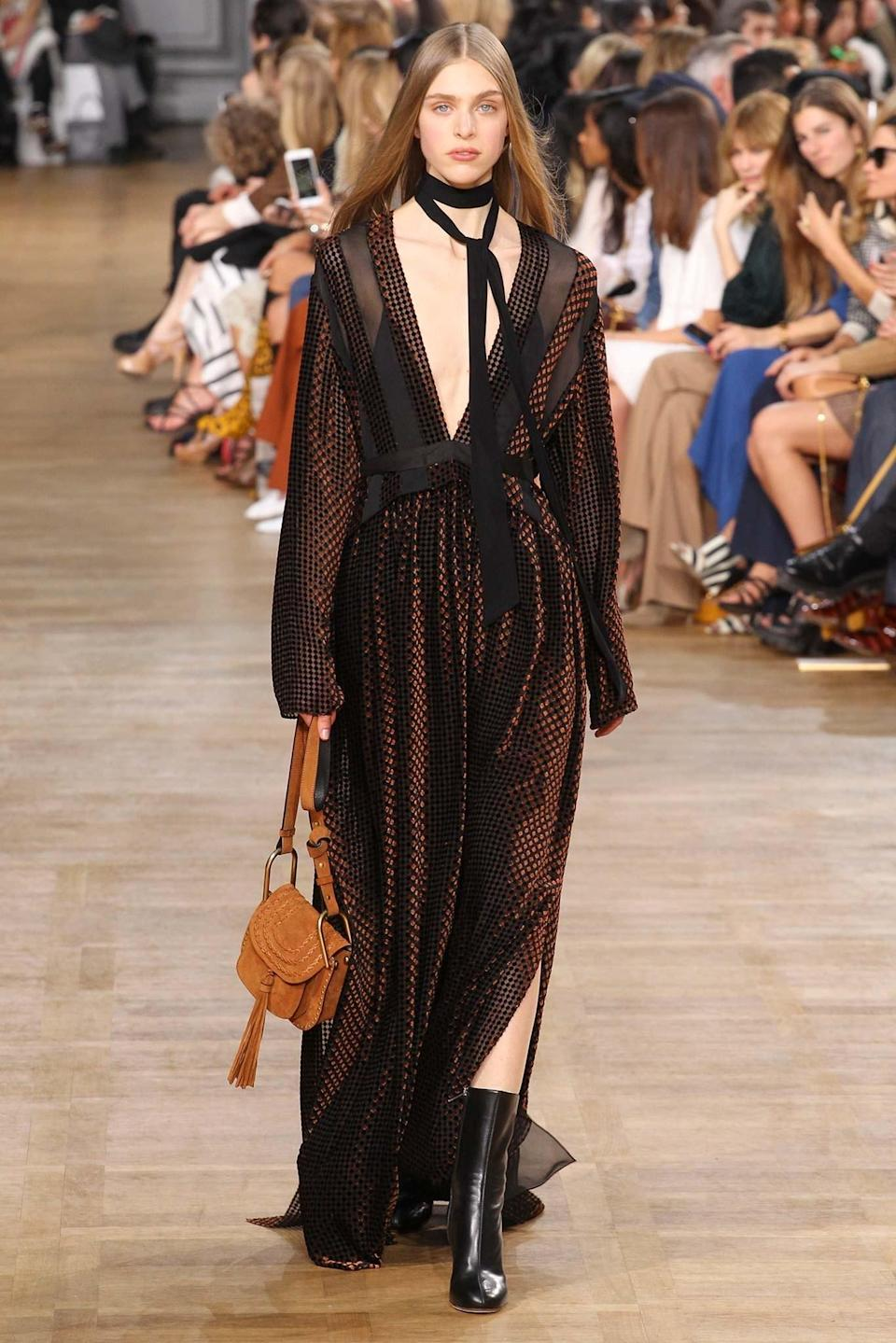 <p>A bohemian-inspired dress from the Fall/Winter 2015 show. (Photo: Getty Images) </p>