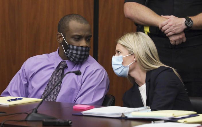 Defendant Nathaniel Roland speaks with lawyer Alicia Goode during a trial in Richland County Courthouse, Columbia, South Carolina on July 20, 2021 (State via Tracy Grants / AP).