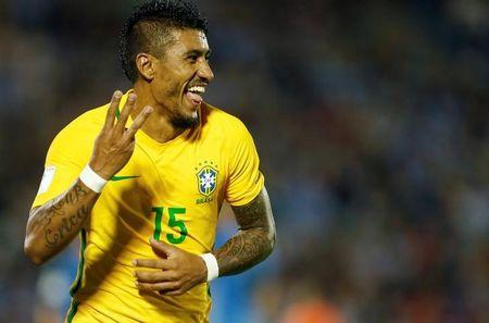 Brazil's Paulinho celebrates his third goal. REUTERS/Andres Stapff