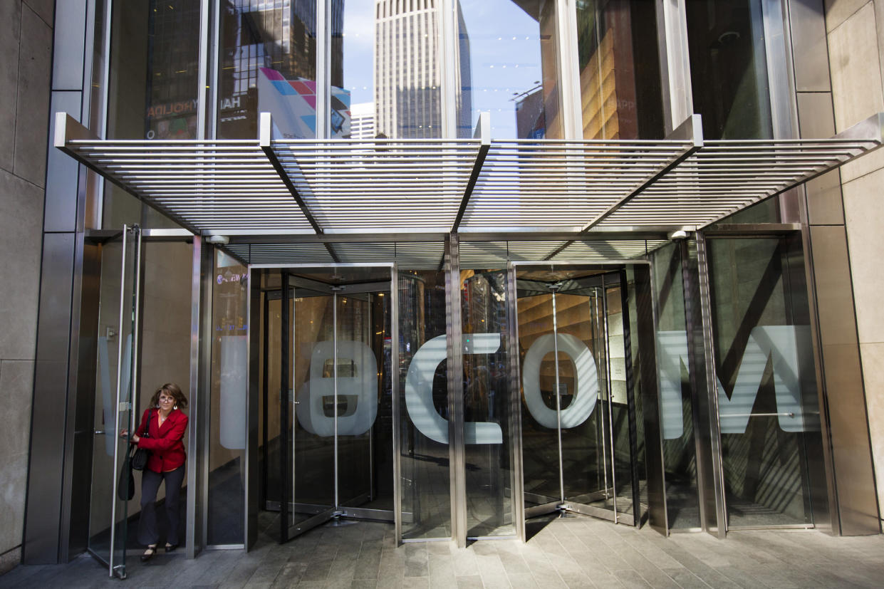 A woman exits the Viacom Inc. headquarters in New York April 30, 2013. REUTERS/Lucas Jackson (UNITED STATES - Tags: BUSINESS MEDIA)