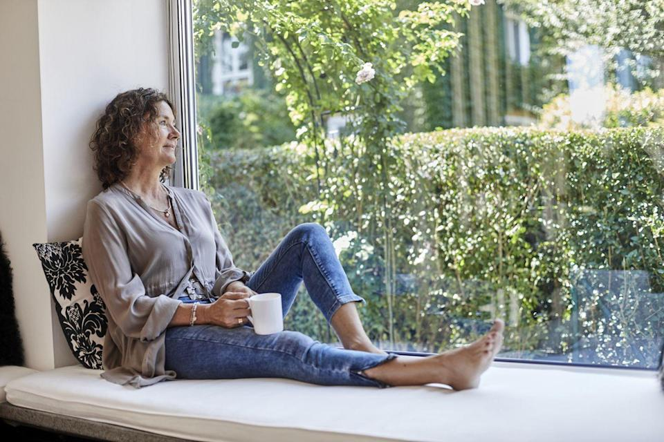 """<p>If you're not able to take a walk outside, then at least give yourself a few minutes to get away from your workspace. Go stand by a window, walk up and down the stairs, or even just go into a different room. Just make sure you're standing up and moving in some way: <a href=""""https://pubmed.ncbi.nlm.nih.gov/27100368/"""" rel=""""nofollow noopener"""" target=""""_blank"""" data-ylk=""""slk:Studies"""" class=""""link rapid-noclick-resp"""">Studies</a> show that even walking around inside can help you feel less drowsy. </p><p>A great time to do this is during lunch. Instead of eating in front of your computer, go somewhere else, whether it's the office kitchen or your backyard. A German study published in the journal <em>PLOS ONE</em> looked at the psychological consequences of <a href=""""https://www.huffpost.com/entry/eating-at-your-desk-stress-less-creative_n_3696608"""" data-ylk=""""slk:eating at your desk"""" class=""""link rapid-noclick-resp"""">eating at your desk</a> by studying groups of people who ate at their desk or went out for lunch. They found that the people who went out reported greater feelings of relaxation and an overall better mood. </p>"""