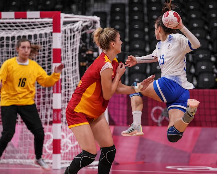 <p>Anna VYAKHIREVA (13) of Team ROC in action in the Women's Quarterfinal handball match between Montenegro and ROC during the Tokyo 2020 Olympic Games at Yoyogi National Stadium on August 04, 2021 in Tokyo, Japan. (Photo by Alexander Safonov/Anadolu Agency via Getty Images)</p>