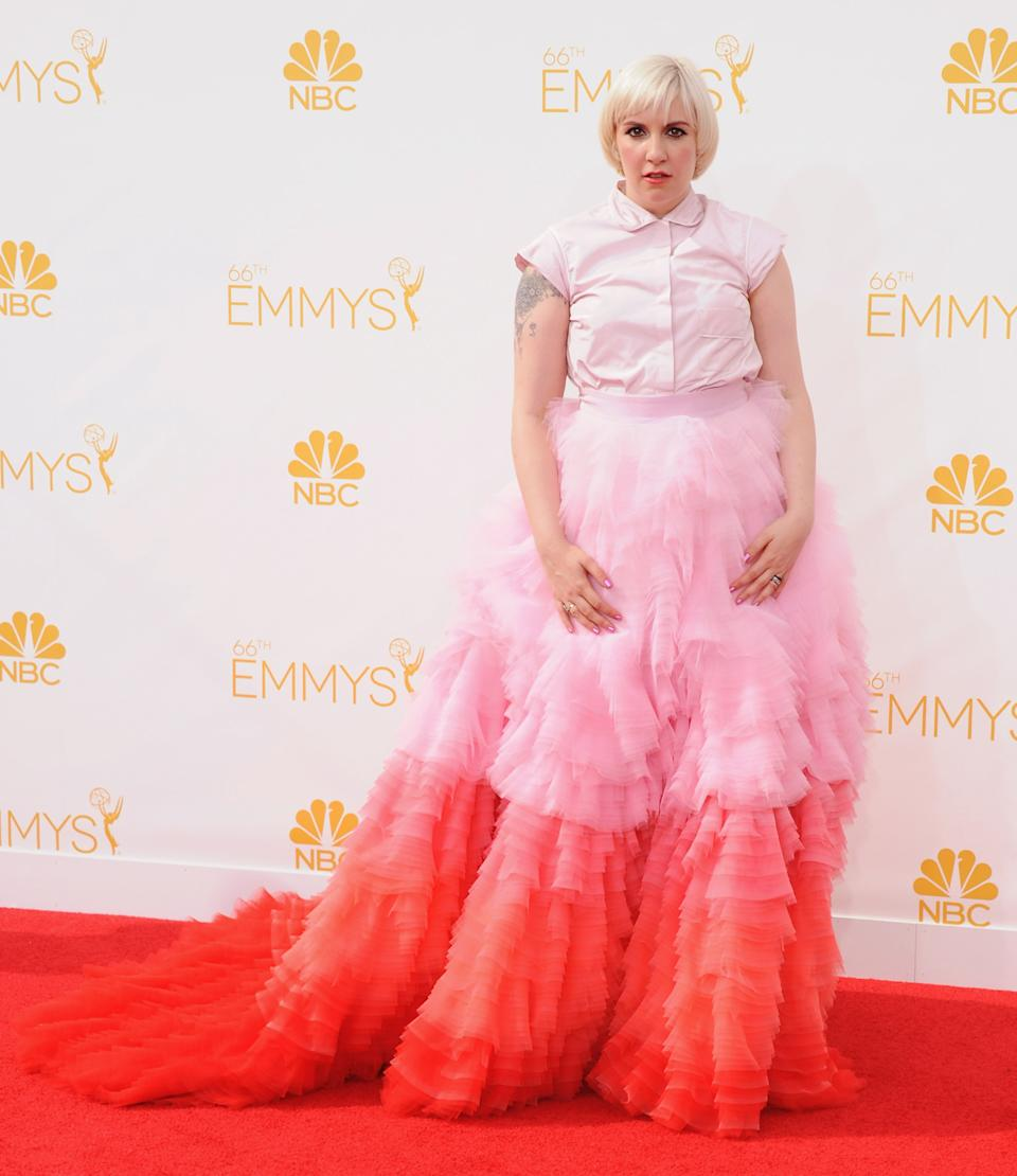 """<p>Lena Dunham arrived at the 2014 Emmys in an over-the-top look by Giambattista Valli that made the """"Girls"""" creator look less like a star and more like a child playing dress-up. (Image via Getty Images)</p>"""