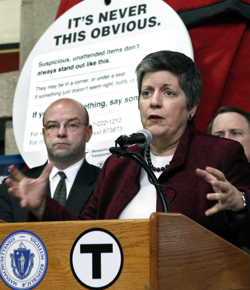 U.S. Homeland Security Secretary Janet Napolitano speaks during a news conference in Boston, Monday, March 14, 2011, to launch a new initiative to help keep the transit system safe and highlight the role of science and technology in securing the nation. Listening at left is Massachusetts Dept. of Transportation Secretary Jeffrey Mullan. (AP Photo/Elise Amendola)