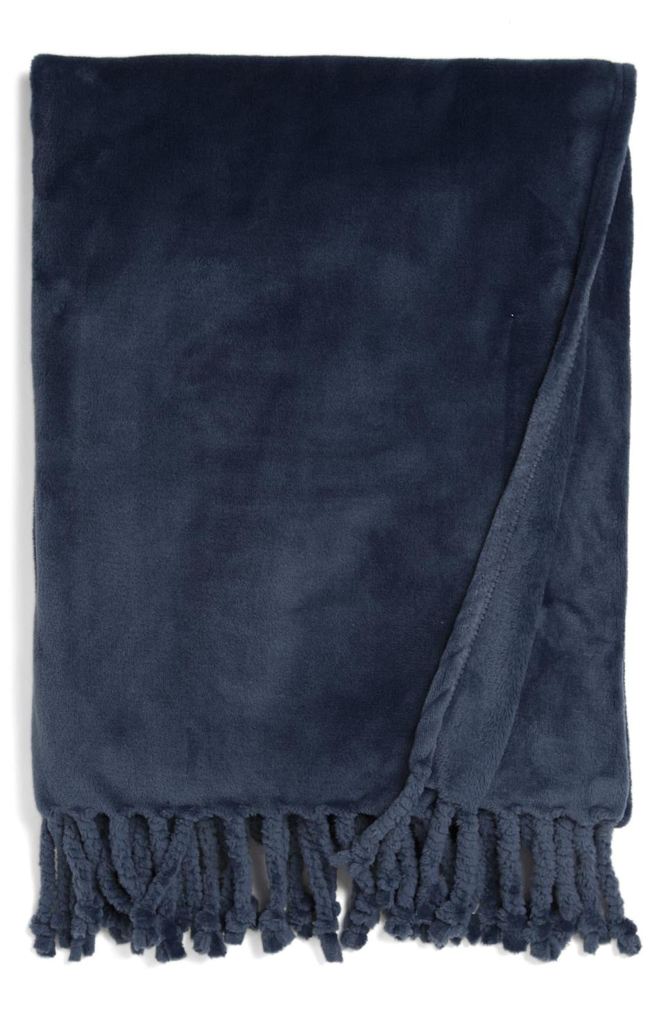 """<h2>Nordstrom Bliss Plush Throw 37% Off<br></h2><br>""""It's never too early to stock up on comfy-looking blankets! And these look so soft and nice, you know I'll be buying them! I'm a big fan of the color options and the cute tassels.""""<em> – Mercedes Viera, Associate Deals Writer</em><br><br><em>Shop</em> <strong><em><a href=""""http://nordstrom.com"""" rel=""""nofollow noopener"""" target=""""_blank"""" data-ylk=""""slk:Nordstrom"""" class=""""link rapid-noclick-resp"""">Nordstrom</a></em></strong><br><br><br><strong>Nordstrom</strong> Bliss Plush Throw, $, available at <a href=""""https://go.skimresources.com/?id=30283X879131&url=https%3A%2F%2Fwww.nordstrom.com%2Fs%2Fnordstrom-bliss-plush-throw%2F3564757"""" rel=""""nofollow noopener"""" target=""""_blank"""" data-ylk=""""slk:Nordstrom"""" class=""""link rapid-noclick-resp"""">Nordstrom</a>"""