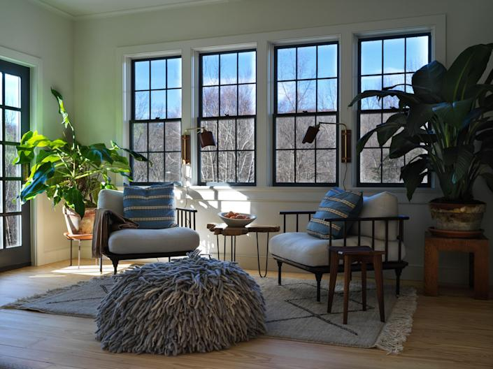 Rouse home chairs make for a cozy reading area at the far end of the living room.