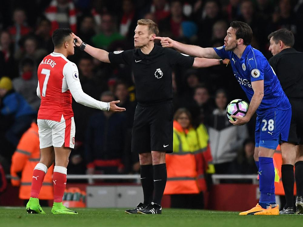Alexis Sanchez was yellow-carded for his part in the spat with Christian Fuchs: Getty