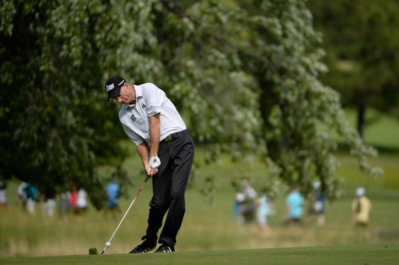 Jim Furyk hits his approach to the 11th hole during the third round of the RBC Canadian Open at the Royal Montreal Golf Club on July 26, 2014