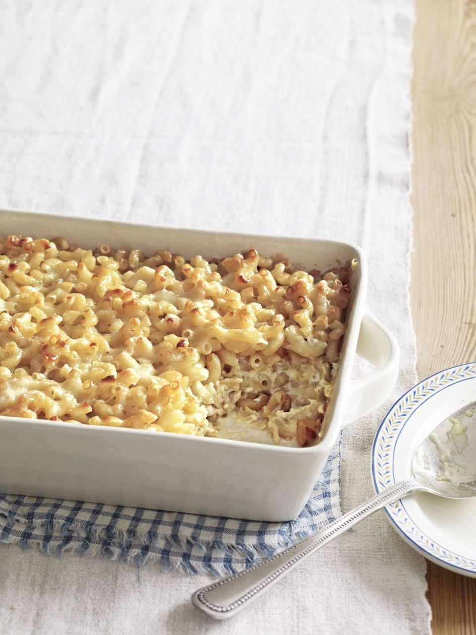 """<p>Update this traditional dish with a slightly sweet, slightly salty cheese. Even better: This version requires just five ingredients and 10 minutes to prep.</p><p><strong><a href=""""https://www.countryliving.com/food-drinks/recipes/a3690/macaroni-gruyere-cheese-recipe-clx0311/"""" rel=""""nofollow noopener"""" target=""""_blank"""" data-ylk=""""slk:Get the recipe."""" class=""""link rapid-noclick-resp"""">Get the recipe.</a></strong></p>"""