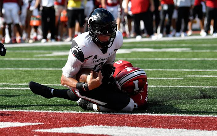 Bearcats quarterback Desmond Ridder tries to get away from Hoosiers defensive back Marcelino McCrary-Ball for a touchdown during the second half.