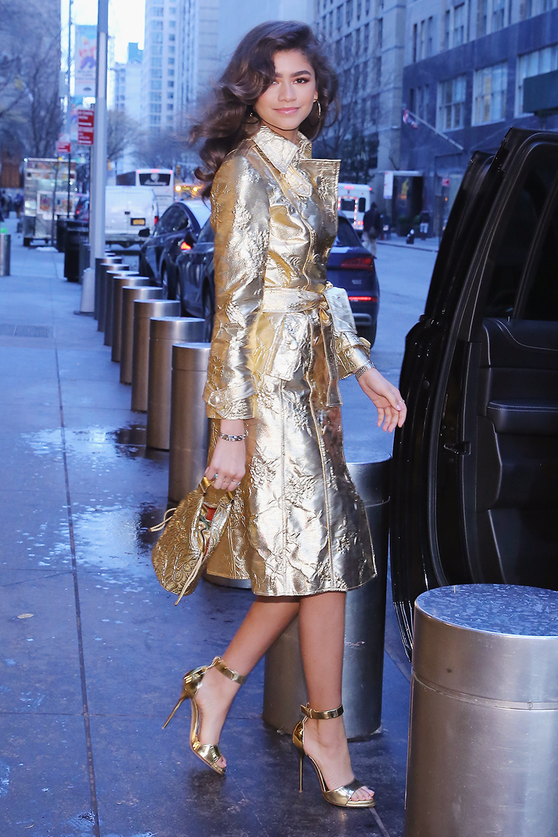 <p>This gold Giuseppe di Morabito coat and matching Paul Andrew heels is so chic, it belongs in a damn museum.</p>