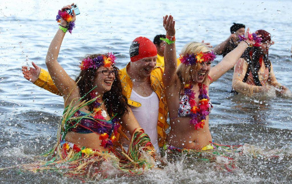 Swimmers in fancy dress participate in the New Year's Day Looney Dook swim at South Queensferry in Scotland January 1, 2013.