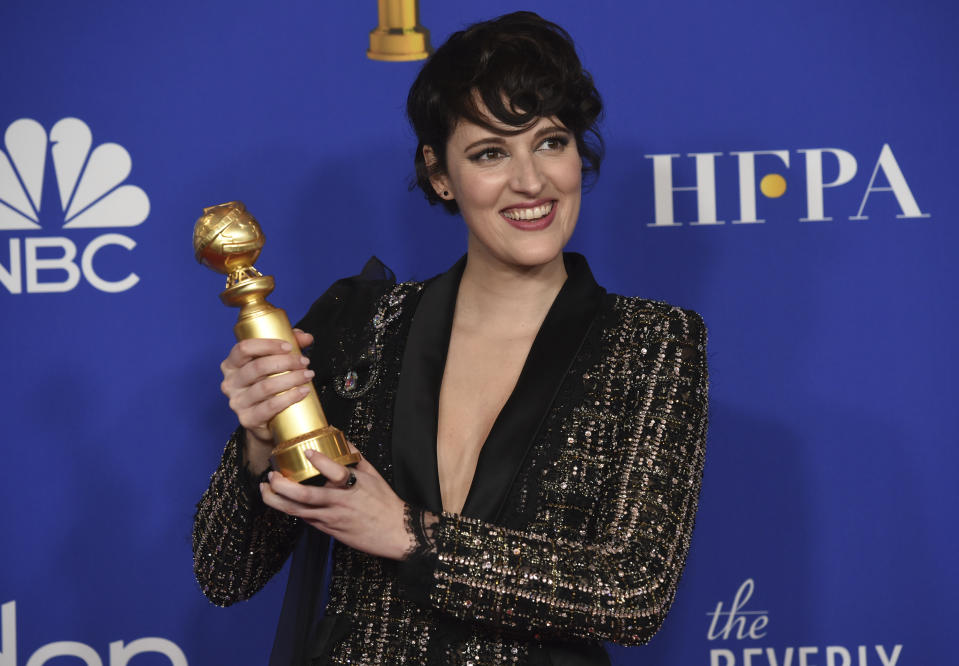 """Phoebe Waller-Bridge poses in the press room with the award for best performance by an actress in a television series, musical or comedy, for """"Fleabag"""" at the 77th annual Golden Globe Awards at the Beverly Hilton Hotel on Sunday, Jan. 5, 2020, in Beverly Hills, Calif. (AP Photo/Chris Pizzello)"""