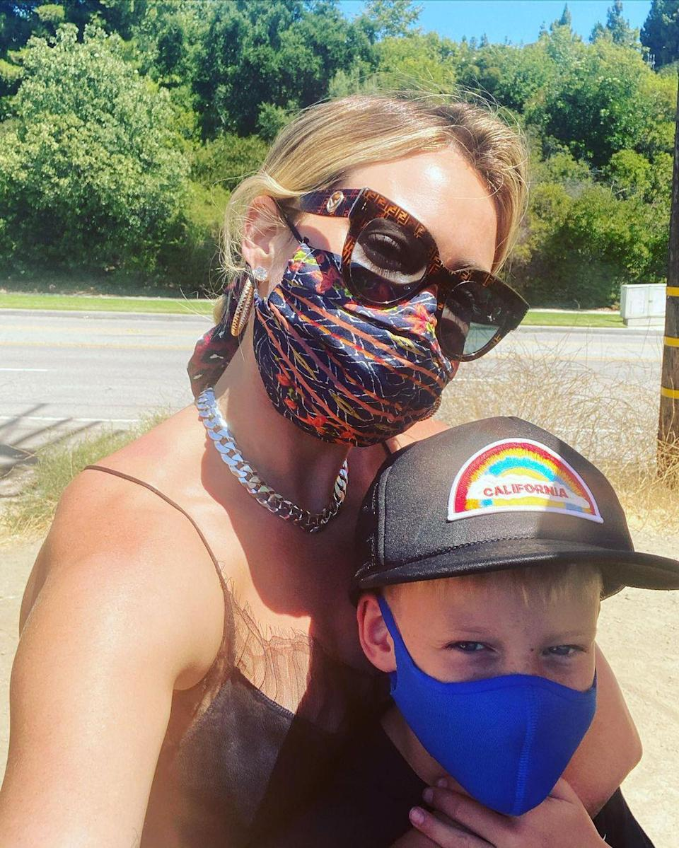 """<p>""""A Sunny shine day with my sunshine boy. Two more years and he's going to be taller than me 😩🌱,"""" Duff <a href=""""https://www.instagram.com/p/CDAvLrfjdSo/"""" rel=""""nofollow noopener"""" target=""""_blank"""" data-ylk=""""slk:lamented on Instagram"""" class=""""link rapid-noclick-resp"""">lamented on Instagram</a> alongside a cute photo with 8-year-old Luca. </p>"""