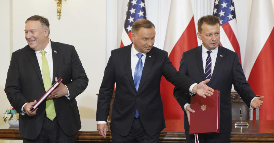 US Secretary of State Mike Pompeo, left, Poland's President Andrzej Duda, center, and Poland's Minister of Defence Mariusz Blaszczak after signing the US-Poland Enhanced Defence Cooperation Agreement in the Presidential Palace in Warsaw, Poland, Saturday Aug. 15, 2020. Pompeo is on a five day visit to central Europe. (Janek Skarzynski/Pool via AP)
