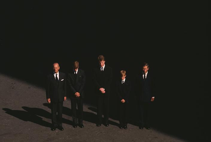 """Prince Philip stands with Prince William, Earl Charles Spencer, Prince Harry and Prince Charles at the funeral of Princess Diana, on Sept. 6, 1997.<span class=""""copyright"""">Robert Wallis—Corbis/Getty Images</span>"""