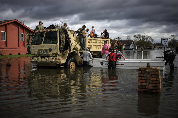 First responders drive a high water vehicle through flooded streets while rescuing residents from floodwater left behind by Hurricane Ida in LaPlace, La., on Aug. 30, 2021. (Luke Sharrett / Bloomberg via Getty Images)
