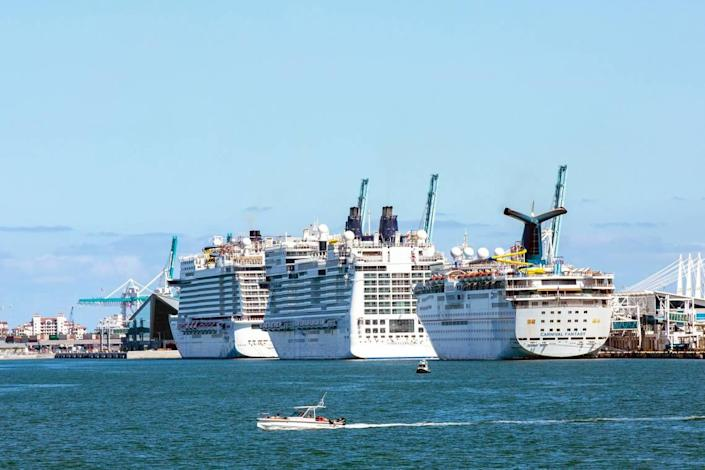 Cruise ships are docked and lined up at Port of Miami in Miami, Florida on Monday, May 4, 2020.