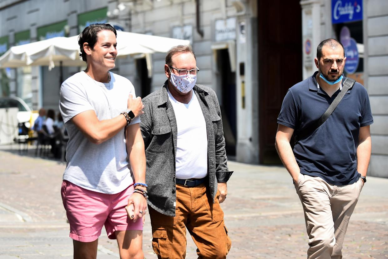Actor Kevin Spacey walks down Carlo Alberto street as he visits the city, where he is expected to return for a cameo appearance in a low budget Italian film, after largely disappearing from public view, in Turin, Italy, June 1, 2021. REUTERS/Massimo Pinca