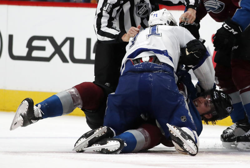 Tampa Bay Lightning center Anthony Cirelli, front, fights with Colorado Avalanche defenseman Ryan Graves in the third period of an NHL hockey game Monday, Feb. 17, 2020, in Denver. The Lightning won 4-3 in overtime. (AP Photo/David Zalubowski)