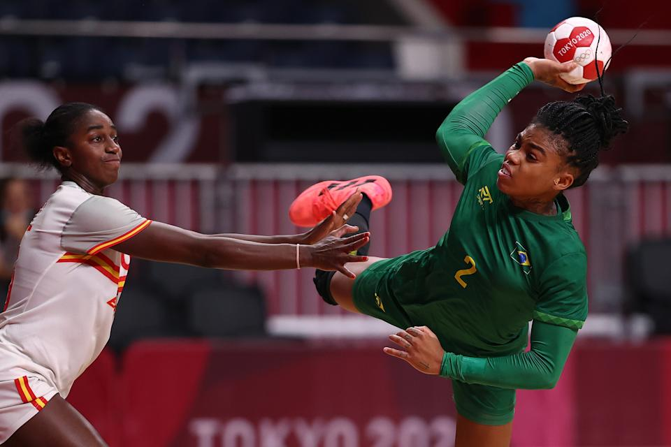 <p>Bruna de Paula of Team Brazil shoots and scores a goal as Alexandrina Cabral Barbosa of Team Spain attempts to defend during the Women's Preliminary Round Group B handball match between Spain and Brazil on day six of the Tokyo 2020 Olympic Games at Yoyogi National Stadium on July 29, 2021 in Tokyo, Japan. (Photo by Dean Mouhtaropoulos/Getty Images)</p>