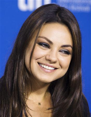 "Cast member Mila Kunis speaks during the ""Third Person"" news conference at the 38th Toronto International Film Festival in Toronto in this file photo taken September 10, 2013. REUTERS/Mark Blinch/Files"