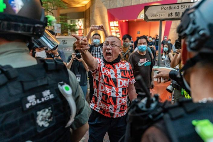 Democratization supporters shouted to the riot police during an anti-National Security Act rally in the Mongkok district in Hong Kong, China, on June 12, 2020. To commemorate the first anniversary of a massive clash between police and democratic demonstrators over the controversial expulsion bill, protesters paid attention to online phone calls to get together.