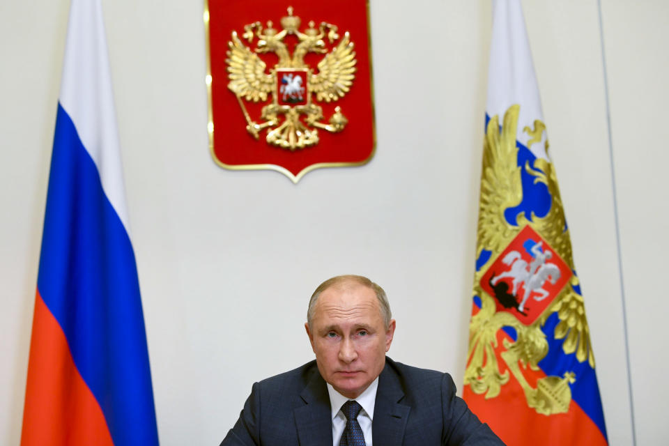 """Russian President Vladimir Putin attends a meeting via video conference at the Novo-Ogaryovo residence outside Moscow, Russia, Wednesday, Dec. 2, 2020. Russian President Vladimir Putin announced start of large-scale vaccination of medics and teachers against COVID next week. Speaking during an online meeting dedicated to inauguration of new hospitals for coronavirus patients built by Russian Defense Ministry, Putin said Russia has enough capacity to start """"large-scale"""" vaccination of teachers and doctors. (Alexei Nikolsky, Sputnik, Kremlin Pool Photo via AP)"""